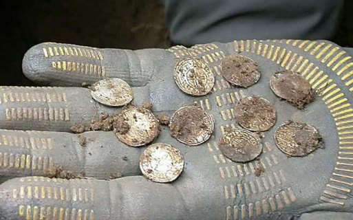 The 5,251 silver coins, which are more than 1,000 years old, were found in a farmer's field near Aylesbury in Buckinghamshire. They are said to form one of the largest hoards of Anglo Saxon coins ever found in Britain and is thought to be worth more £1 million when auctioned.