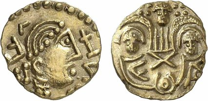 Early Anglo-Saxon. Post-Crondall Type. Gold Thrymsa. «Two emperors» type, ca.655-675. Mint in Kent. Obv: Helmeted bust right. Rev: Emperors enthroned facing crowned by winged Victory. Gold, 1.25 grams. Metcalf 79-80. SCBC 767. High gold content and Expressive portrait. Rare quality. Virtually as struck with high reliefs. Exceptional Condition. Almost Uncirculated