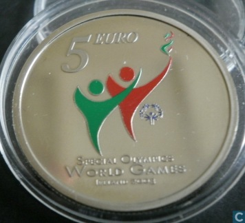 The extra coin is a €5 coin with the Special Olympics logo on the reverse