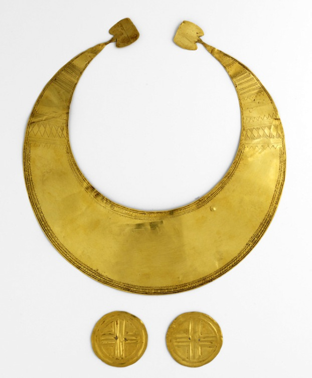 Gold Lunula (2010:246) and Gold Discs (2010:247, 2010:248), Coggalbeg, Co. Roscommon. In 1947, for reasons still uncertain, Hubert Lannon handed these golden objects over to Mr Patrick Sheenan, a pharmacist in the town of Strokestown, Co. Roscommon. It appears that neither man fully appreciated the value of the artefacts and the National Museum of Ireland was not notified of their existence. Instead, Mr. Sheenan placed the artefacts in his family safe where they were to remain hidden for the next 50 years, only occasionally being brought out and shown to curious visitors.