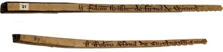 "A wooden stick for recording transactions. Made in England in the third quarter of the thirteenth century, the first stick reads ""£9.4s.4d. from Fulk Basset for the farm of Wycombe""; probably Fulco Basset, bishop of London, who died of the plague in 1259. The second one reads: ""£4. 8p. from Robert of Curclington for an injustice."""