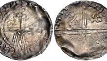 "Hiberno-Norse. temp. Murchad mac Diarmata. 1052-1070. AR Penny (18mm, 0.50 g, 9h). Phase IV coinage, Facing bust/Long Cross type. Uncertain mint signature and moneyer. Struck circa 1055/60-1065/70. IIIIIIIIIII•III[...] II•I[...]IIII, schematized facing bearded head: pellet-in-annulet eyes, annulet cheeks, curvilinear mouth and mustache with one pellet at end, and linear beard; annulet above / IIIIII III, voided long cross, with triple crescent ends; in first and fourth angles, retrograde S with triple pellets at each end, ""hand"" symbol in second, and annulet-with-tail symbol in third. Blackburn 4, –; O'S 46 var. (symbol in third quarter); SCBI 8 (BM), –; cf. SCBI 32 (Belfast), 309; SCBI 22 (Copenhagen), 235; D&F 27; SCBC 6176. VF, toned, area of weak strike. Very rare."
