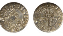 Hiberno-Norse Coinage. Anlaf V (ca. 1029-1034). 'Cnut-style' Penny. struck likely at Dublin, moneyer: Oda (?) Draped bust l. breaking circle, wearing pointed helmet and holding scepter; +∧NLF +CVIN-E (the 'N' retrograde), rev. Central double circle enclosing pellet, which intersects a voided and a jeweled cross within a circle; +OD∧:ON (the 'N' retrograde) DNLNVF