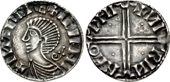 Hiberno-Norse. Sihtric III Olafsson. 995-1036. AR Penny (17.5mm, 1.20 g, 7h). Phase II coinage, Long Cross type. Difelin (Dublin) mint signature; 'Nirinn,' moneyer. Struck circa 1018-1035. + I?TRC RE+ IDIFHI, draped bust left; inverted croizer behind / + ?I RI? N HO DFII, voided long cross, with triple crescent ends; pellet in each angle. O`S 12 (same rev. die as illustration); SCBI 22 (Copenhagen), 88 (same dies); D&F 23; SCBC 6125A. Good VF, toned.