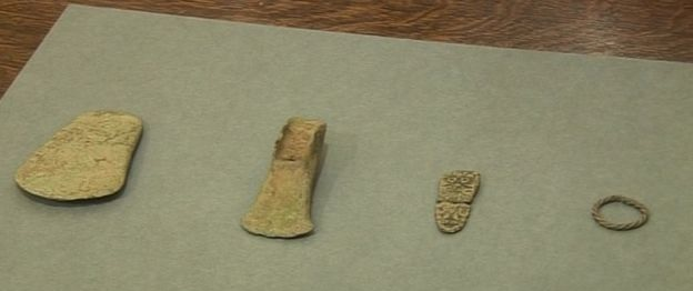 Two Bronze Age axe heads, Viking strap-end and twisted ring were illegally excavated