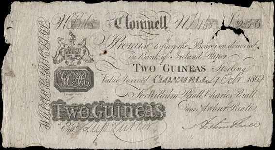 Clonmell Bank, Two Guineas (Two Pounds, Five Shillings and Sixpence), 4 October 1809, B 168, payable in Bank of Ireland Paper, for William Riall, Charles Riall and Arthur Riall, signature of Arthur Riall. Endorsements on back, pinholes, small holes, tear and missing small piece at top right, otherwise very good. The Old Currency Exchange, Dublin, Ireland.