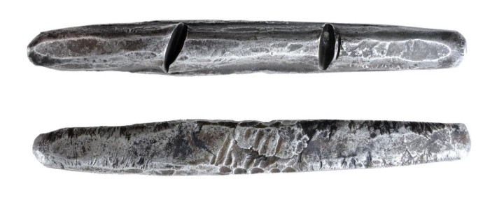 A 'cast' Viking Silver Trade Ingot, c. 800-1000 AD – a sub-rectangular in plan and ovate in section, and tapering to a rounded point at each end. The Old Currency Exchange, Dublin, Ireland.
