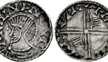 An Hiberno-Norse silver penny, Phase III, Class E (Bust with Symbols), Type 1a (Pellet before Face), with 2 stylised hands on reverse. The Old Currency Exchange, Dublin, Ireland.