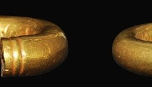 Gold Ring Money - Penannular ring, thick-walled hollow gold cylinder with ridged decoration at each end, carefully formed into an annular ring with small opening. 3.74g. Late Bronze Age, 700-500 BC