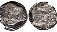 An Hiberno-Norse, Phase V, Class B Silver Penny. Draped bust left with quatrefoil before. Voided short cross with annulet center and triple crescent ends. Uncertain mint signature and moneyer. 19mm. 0.45g