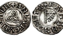 """Hiberno-Norse Northumbria). Anlaf Sithtricsson (Cuaran). First reign, 941-944/5. AR Penny (19mm, 0.98 g, 9h). Triquetra type. York mint; """"Ranan"""", moneyer. + ·A·NL·A·F CVNVNCIΓ, triquetra / + R·A·N·A·N MONET·Λ, fringed triangular standard bearing 'X' on cross-tipped pole. CTCE Group V (unlisted moneyer); SCBI -; BMC –; North 540; SCBC 1020 (this coin illustrated). Near EF. Extremely rare, previously unrecorded for this moneyer, who is also unattested for any other ruler."""